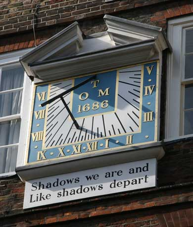 The Sundial in Pump Court Temple. It reads Shadows We Are And Like Shadows Depart.